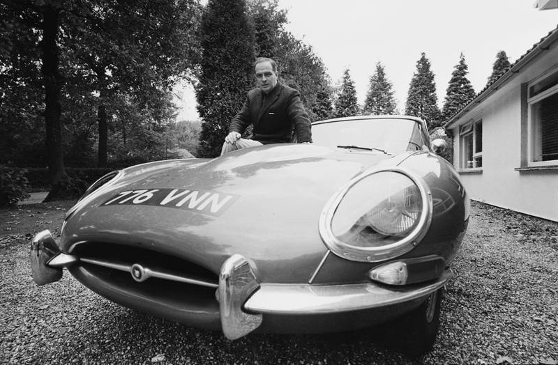 British automobile designer Roy D. Haynes, who designed the 1966 Ford Cortina MkII, after his move to the BMC, UK, 20th October 1967. He is pictured with an E-type Jaguar. (Photo by Les Lee/Daily Express/Getty Images)