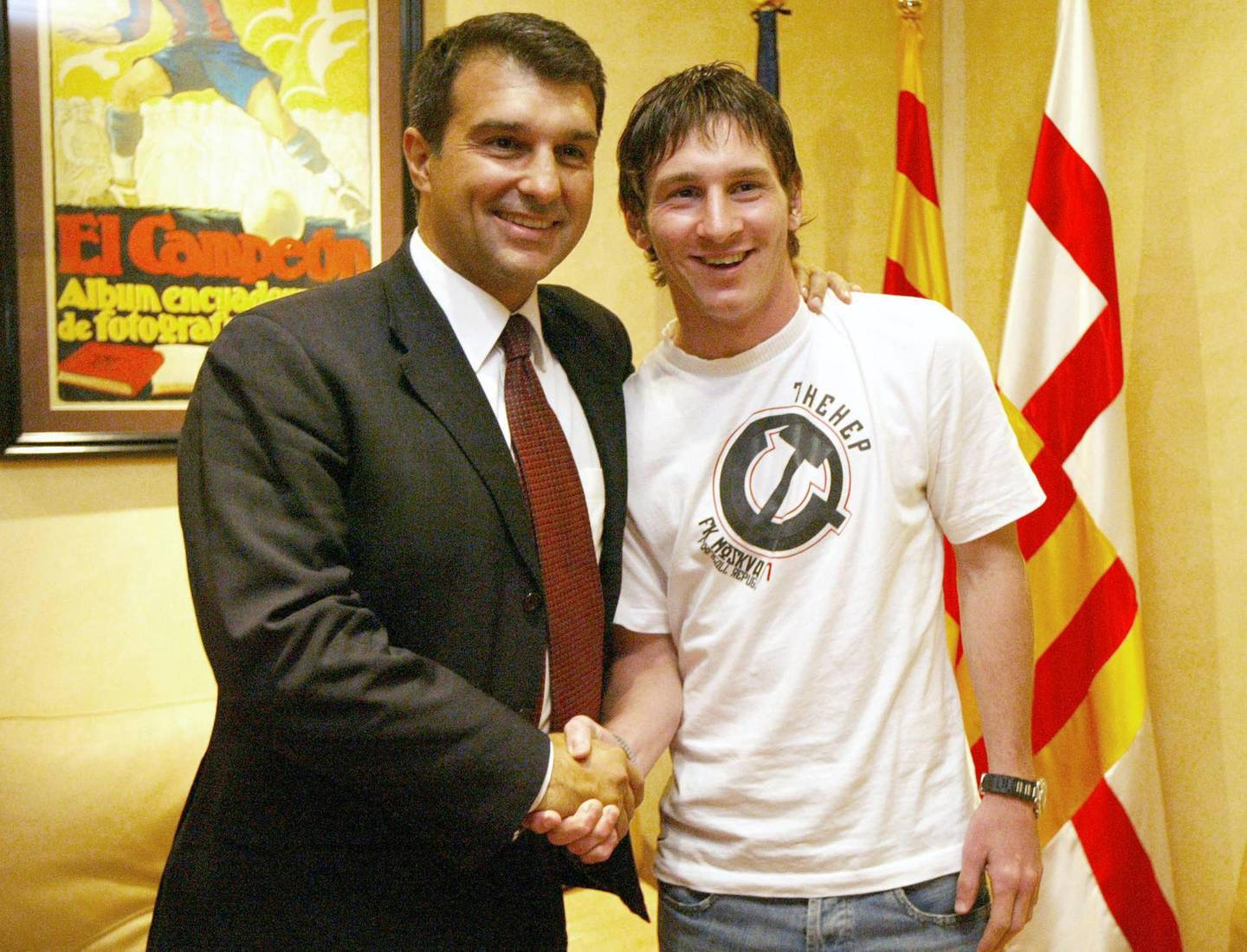 Hand out photograph of Barcelona's Argentinian football player Lioneleo Messi (R) shaking hands with FC Barcelona's President Joan Laporta (L) dated 16 September 2005 after Messi extended his contract until 2014 at Nou Camp Stadium in Barcelona. Messi has reached an agreement for the extension of the Argentinean player's contract until 30 June 2014, and includes a 150 million euro buyout clause.   AFP PHOTO FCBARCELONA.COM (Photo by FCBARCELONA.COM / FCBARCELONA.COM / AFP)