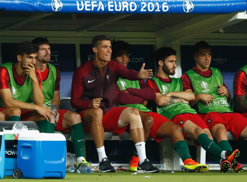 PARIS, FRANCE - JULY 10:  Cristiano Ronaldo of Portugal shouts encouragement to his teammates from te bench during extra-time of the UEFA EURO 2016 Final match between Portugal and France at Stade de France on July 10, 2016 in Paris, France.  (Photo by Clive Rose/Getty Images)