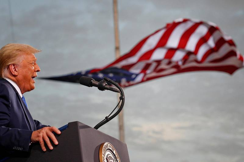FILE PHOTO: FILE PHOTO: President Donald Trump speaks, with a flag behind him, during a campaign rally at Cecil Airport in Jacksonville, Florida, September 24, 2020. REUTERS/Tom Brenner/File Photo/File Photo