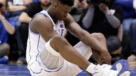 Nike shares take a hit after basketball player's shoe splits