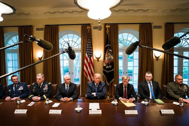 epaselect epa06658048 US President Donald J. Trump (C) speaks with the media before a meeting with his military leadership in the Cabinet Room of the White House in Washington DC, USA, 09 April 2018. Trump said he will decide in the next few days whether the US will respond militarily for the reported chemical weapons attack in Syria. Trump also spoke about the FBI raid of his personal attorney Michael Cohen's office.  EPA/JIM LO SCALZO