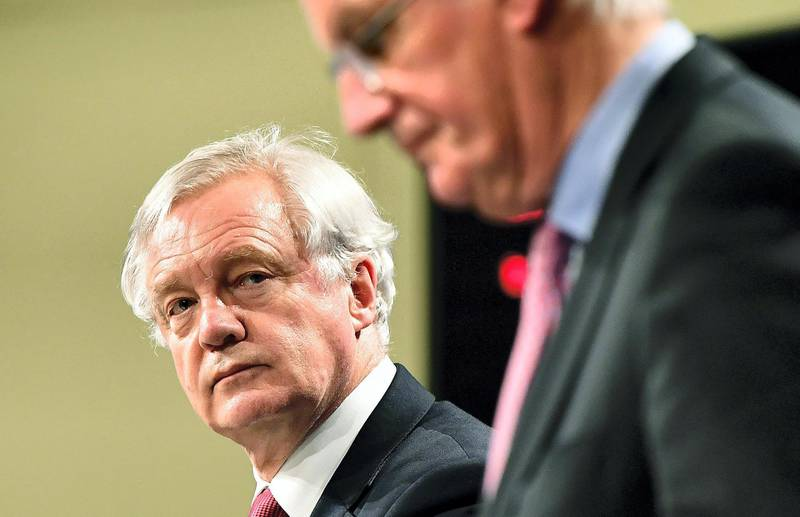 British Secretary of State for Exiting the European Union (Brexit Minister) David Davis (L) and European Commission member in charge of Brexit negotiations with Britain, Michel Barnier address a press conference at the end of the first day of Brexit negotiations at the European Commission in Brussels on June 19, 2017. - Britain and the European Union started Brexit negotiations in Brussels on June 19, 2017. (Photo by EMMANUEL DUNAND / AFP)