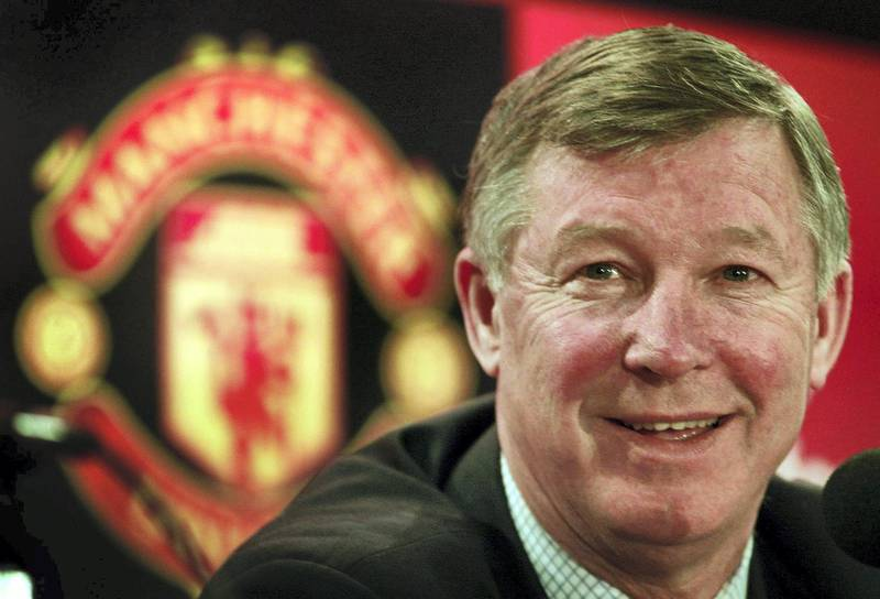 MANCHESTER UNITED'S MANAGER SIR ALEX FERGUSON TALKS TO THE MEDIA AFTER SIGNING A THREE YEAR EXTENTION TO HIS CONTRACT.   Manchester United manager Sir Alex Ferguson talks to the media during a news conference at Old Trafford February 28, 2002. Ferguson expressed his delight with the new three year contract and admitted he had not been able to bring himself to leave the club. REUTERS/Ian Hodgson - RP3DRHYVEAAA