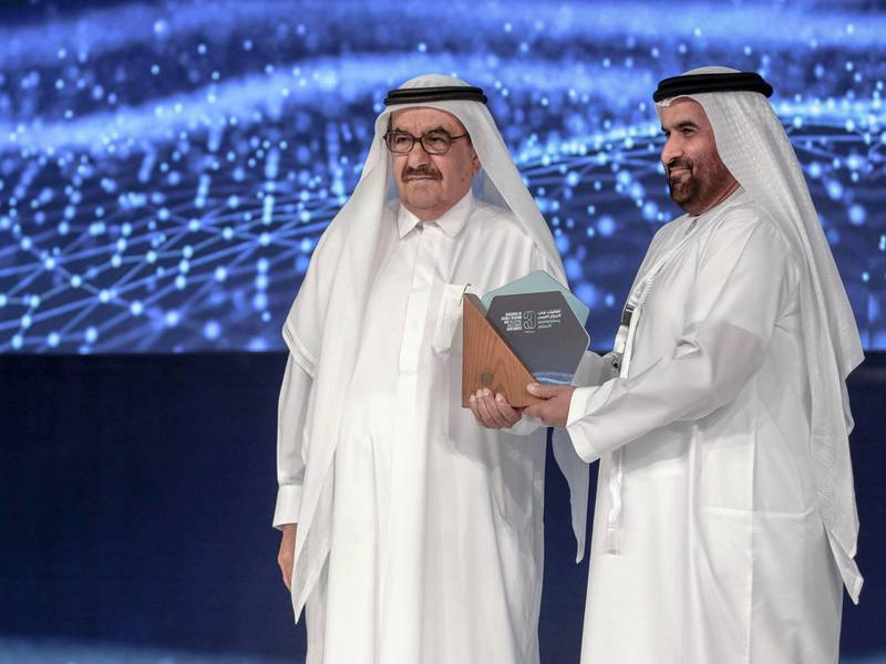 Dubai, United Arab Emirates, March 11, 2019.  The UAE is celebrating 30 years of signing Double Taxation Avoidance Agreements (DTA) and Bilateral Investment Treaties (BIT). -- (L-R)  H.H. Hamdan bin Rashid Al Maktoum, Minister of Finance gives an award to HE Mohammed Ali bin Zayed Al Falasi, Deputy Governor of the UAE Central Bank. Victor Besa/The NationalReporter:  Nada El SawySection:  BZ