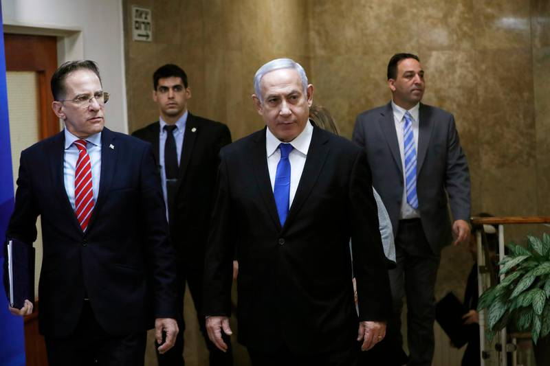 Israeli Prime Minister Benjamin Netanyahu arrives to the weekly cabinet meeting in Jerusalem on Sunday, Dec. 8, 2019. (Ronen Zvulun/ Pool photo via AP)