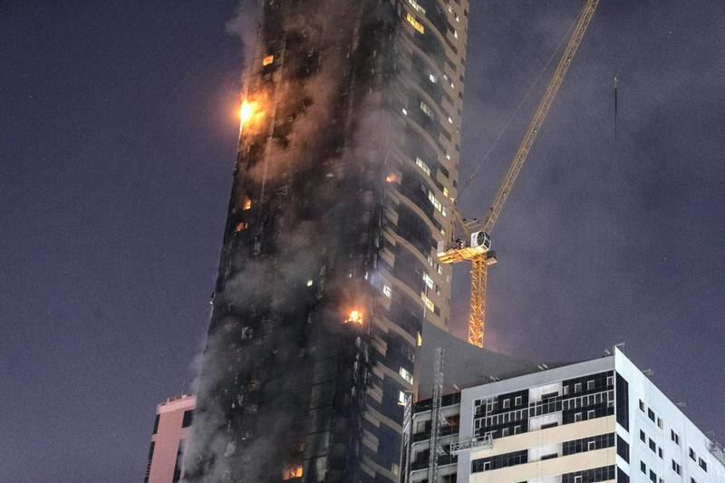 SHARJAH, UNITED ARAB EMIRATES. 05 MAY 2020. STANDALONE. Fire at the Abbco Tower near Nahda Park in Sharjah. Police and fire fighters responded to a blaze that was reported after 8:30. (Photo: Antonie Robertson/The National) Journalist: Salam Al Amir. Section: National.