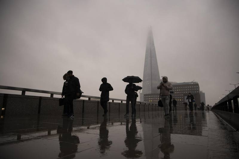 Commuters cross London Bridge in the City of London, U.K., on Monday, Feb. 15, 2021. The U.K. recorded 15 million vaccinations against the coronavirus, a milestone that is set to increase pressure on Prime Minister Boris Johnson to begin reopening the economy. Photographer: Jason Alden/Bloomberg