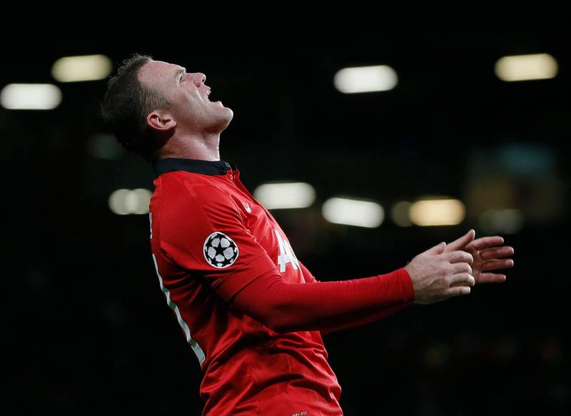 Manchester United's Wayne Rooney reacts after a missed opportunity during their Champions League soccer match against Real Sociedad at Old Trafford in Manchester, northern England October 23, 2013. REUTERS/Phil Noble (BRITAIN - Tags: SPORT SOCCER) *** Local Caption ***  PNN16_SOCCER-CHAMPI_1023_11.JPG