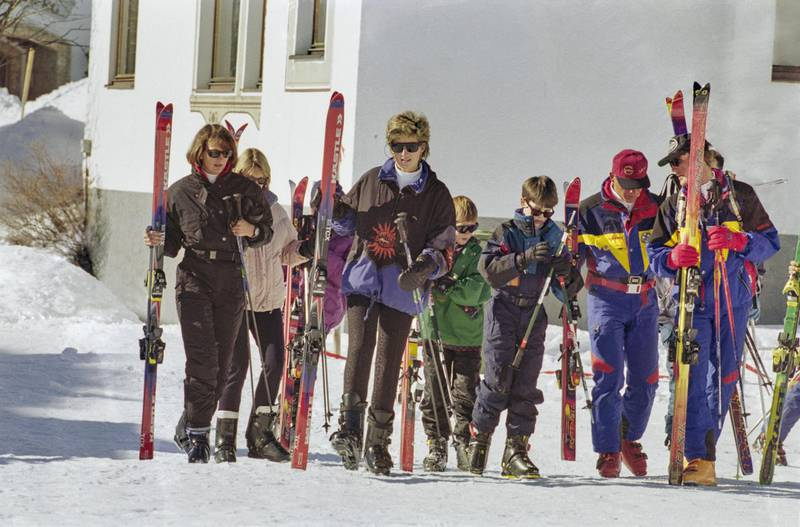 British Royal Diana, Princess of Wales (1961-1997), Prince Harry, and Prince William carrying their skis during a skiing holiday in Lech am Arlberg, Austria, 25th March 1994. (Photo by Princess Diana Archive/Hulton Archive/Getty Images)
