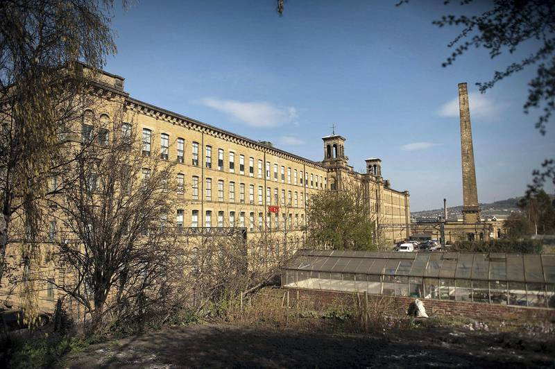 BRADFORD, UNITED KINGDOM - MARCH 30:  A mill built by Sir Titus Salt stands at Saltaire Village World Heritage Site on March 30, 2012 in Bradford, United Kingdom. Saltaire is named after Sir Titus Salt who built a textile mill and housing for his workers on the banks of the River Aire. In 2001 the historic industrial village was granted a World Heritage Site by UNESCO.  (Photo by Bethany Clarke/Getty Images)