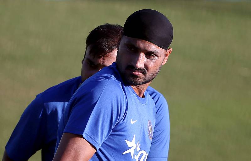 FILE PHOTO: India's Harbhajan Singh (R) and Amit Mishra attend a practice session ahead of their first Twenty-20 cricket match against South Africa in the northern Indian hill town of Dharamsala, India, October 1, 2015. REUTERS/Adnan Abidi/File Photo