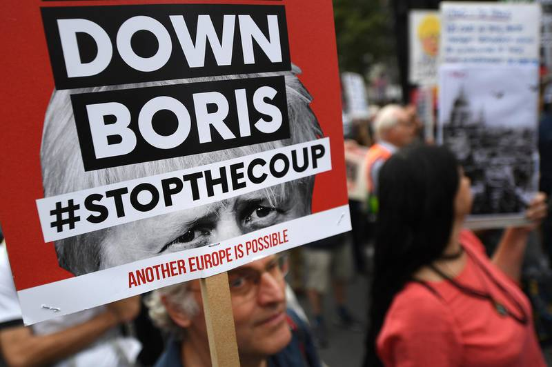 epa07825827 People protest against the government of British Prime Minister Boris Johnson, in London, Britain, 07 September 2019. The event 'Demand Democracy: Johnson Out! #StopTheCoup' calls for the resignation of British Prime Minister Boris Johnson and an end to his Brexit agenda.  EPA/ANDY RAIN