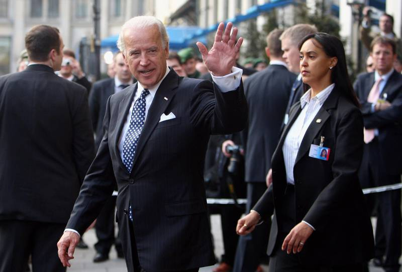 MUNICH, GERMANY - FEBRUARY 07: U.S. Vice President Joseph Biden waves to journalists as he leaves the Bayerischer Hof hotel, the venue of the Munich Security Conference, during the second day of the Munich conference on security policy on February 7, 2009 in Munich, Germany. The 45th Munich conference on security policy is running from February 6 to 8, 2009.  (Photo by Miguel Villagran/Getty Images)