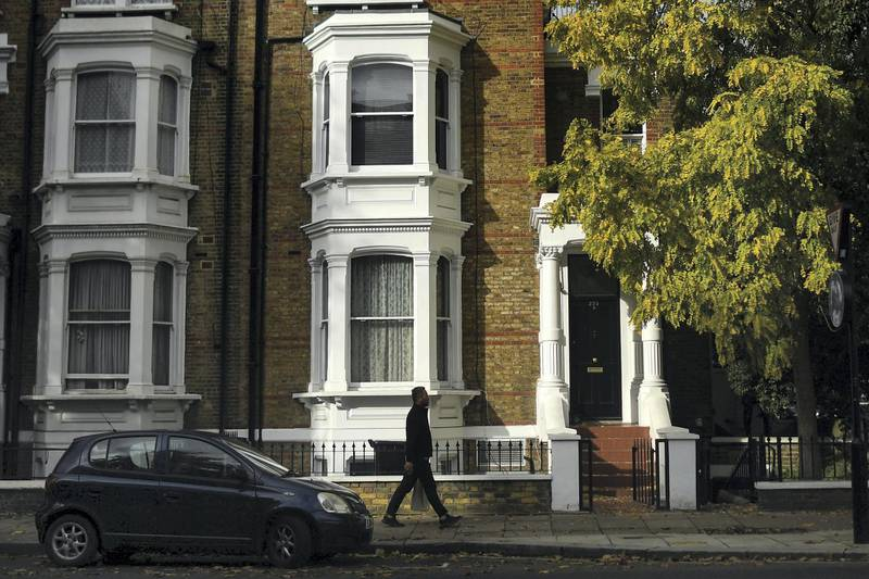 LONDON, ENGLAND - OCTOBER 26: A man walks past houses in Maida Vale on October 26, 2020 in London, England. As many young people renting rooms have left the capital due to the Coronavirus Pandemic, rents are dropping and in some places have fallen by a third. Aldgate has seen a 34% fall in price per room, whilst prices in Little Venice and Maida Vale dropped by 20%. The average rent drop for a room in London's Zone one dropped by 11% in comparison to this time last year. (Photo by Peter Summers/Getty Images)