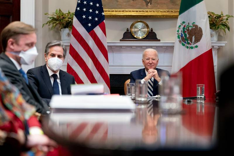President Joe Biden, accompanied by White House national security adviser Jake Sullivan, left, and Secretary of State Antony Blinken, second from left, attends a virtual meeting with Mexican President Andres Manuel Lopez Obrador, in the Roosevelt Room of the White House, Monday, March 1, 2021, in Washington. (AP Photo/Andrew Harnik)