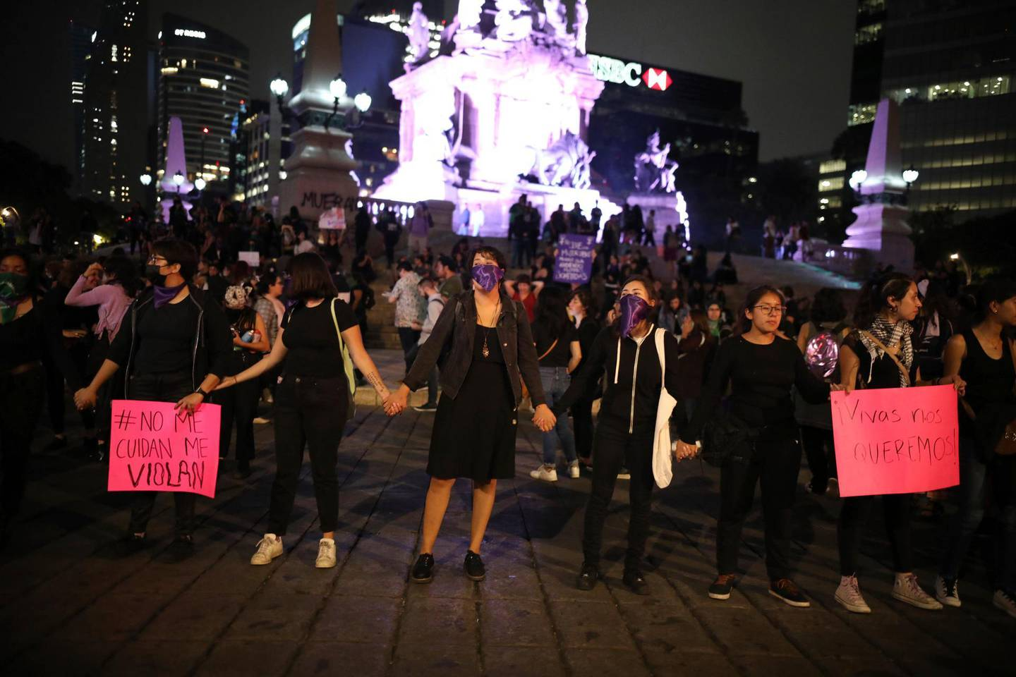 Women holds hands demanding justice and for their safety, during a protest sparked by a string of alleged sexual attacks by police officers, in Mexico City, Friday, Aug. 16, 2019. On Friday, hundreds of women demonstrated largely peacefully in downtown Mexico City. This week, an auxiliary policeman was held for trial on charges he raped a young female employee at a city museum. (AP Photo/Marco Ugarte)