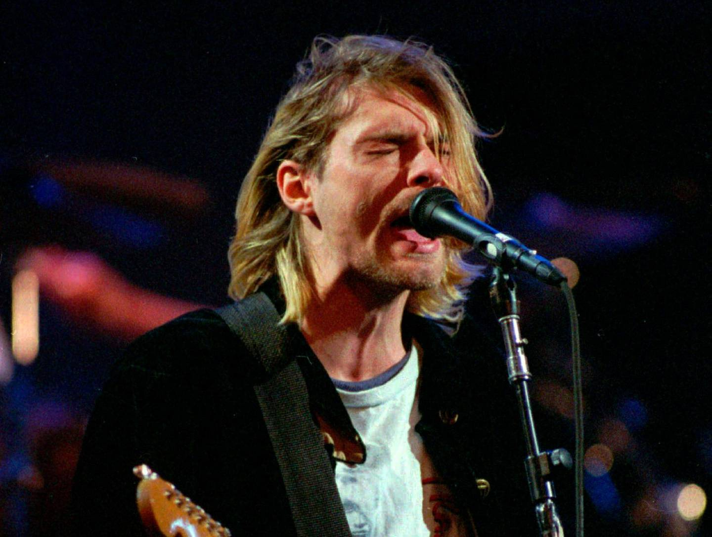 FILE In this Dec. 13, 1993, file photo, Kurt Cobain performs in Seattle. On the 25th anniversary of Cobain's death, dozens of people gathered throughout the day at a Seattle park near the house where the music icon killed himself, leaving flowers, candles and written messages. Cobain, whose band Nirvana rose to global fame amid the city's grunge rock years of the early 1990s, shot himself on April 5, 1994, in his home in a wealthy neighborhood near Lake Washington. (AP Photo/Robert Sorbo, File)