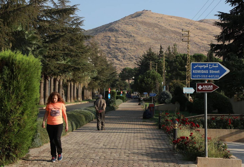 People walk along a street in Lebanon's largely Armenian town of Anjar, Lebanon October 21, 2020. Picture taken October 21, 2020. REUTERS/Mohamed Azakir