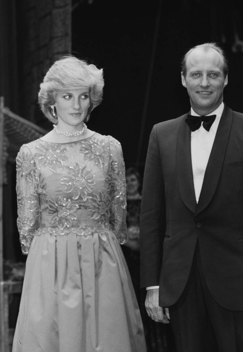 Diana, Princess of Wales (1961 - 1997) with Crown Prince Harald of Norway at a performance by the London City Ballet in Oslo, Norway, 13th February 1984. She is wearing a red evening gown by Jan van Velden. (Photo by Smith/Daily Express/Hulton Archive/Getty Images)