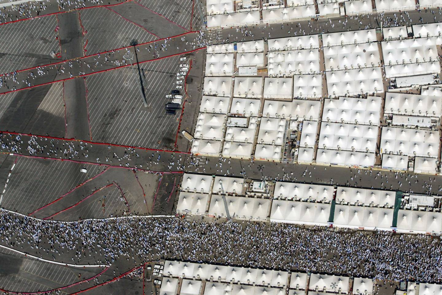 An aerial view of Mina shows pilgrims walking around the Jamarat to throw pebbles at a stone pillar representing the devil, near the tents, during the Hajj on December 09, 2008. (Salah Malkawi/ The National)