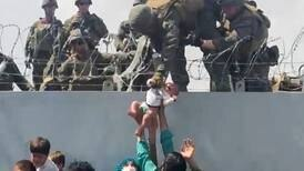 Afghan baby passed over Kabul airport wall now safely living in US