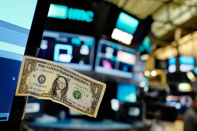 FILE - In this Thursday, Dec. 22, 2016, file photo, a dollar bill is taped to a trader's computer screen at the New York Stock Exchange. The good times keep rolling for fund investors. As of late June 2017, nearly every type of fund logged gains over the three months prior, with technology and foreign stock funds among the top performers. Even bond funds are on pace to deliver returns rivaling their best in recent years. (AP Photo/Mark Lennihan, File)