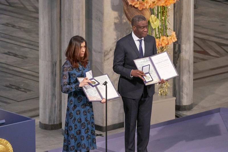 OSLO, NORWAY - DECEMBER 10:  Dr. Denis Mukwege and Nadia Murad pose on stage after receiving the Nobel Peace Prize 2018 at Oslo City Town Hall on December 10, 2018 in Oslo, Norway. The Congolese gynaecologist, Denis Mukwege, who has treated thousands of rape victims, and Nadia Murad, the Iraqi Yazidi, who was sold into sex slavery by Isis, have been jointly awarded the 2018 Nobel peace prize in recognition for their efforts to end the use of sexual violence as a weapon in war.  (Photo by Erik Valestrand/Getty Images)