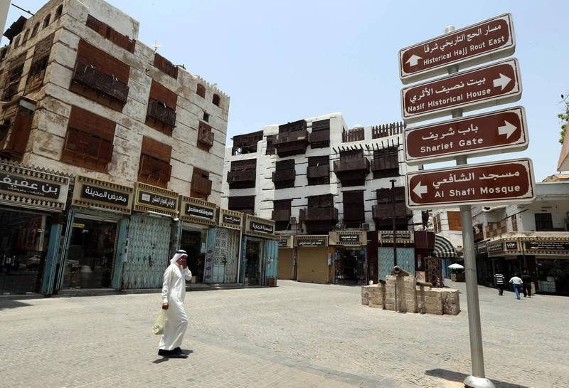 """Windows covered with wooden screens known as """"mashrabaiya"""" adorn traditional buildings in the old  city of the Red Sea port city of Jeddah on June 22, 2014. UNESCO's World Heritage Committee, meeting in the Qatari capital Doha on June 21, 2014, has inscribed the old city of Jeddah and the Gate of Mecca on the World Heritage List.   AFP PHOTO/STR / AFP PHOTO / STR"""