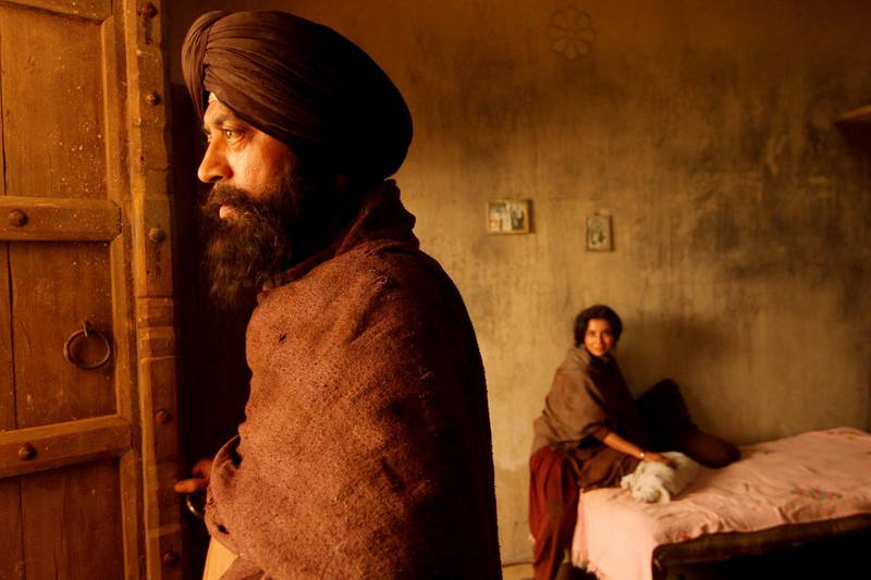 The film Qissa is about a Sikh named Umber Singh (Irrfan Khan, at left) who was forced to flee from his village during the partitioning of India in 1947. He has three daughters but wishes to have a male heir.CREDIT: Courtesy Heimatfilm *** Local Caption ***  al20oc-IrrfanKhan.jpg