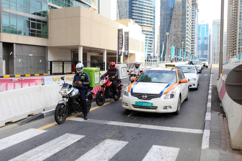 DUBAI, UAE. February 03, 2014 - Photograph of a man driving a motorcycle in Dubai Marina, February 03, 2014.  (Photo by: Sarah Dea/The National, Story by: STANDALONE, STOCK)