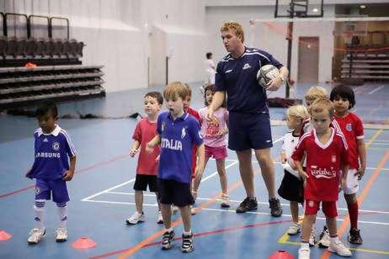 United Arab Emirates - Dubai - July 8th, 2010:  James Masterman works with children in a summer camp at the Sports Hall at Hayya Meadows Club.  (Galen Clarke/The National)
