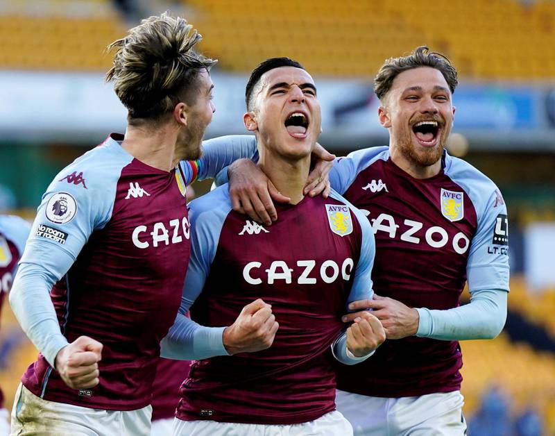 Soccer Football - Premier League - Wolverhampton Wanderers v Aston Villa - Molineux Stadium, Wolverhampton, Britain - December 12, 2020 Aston Villa's Anwar El Ghazi celebrates scoring their first goal with Matty Cash and Jack Grealish Pool via REUTERS/Tim Keeton EDITORIAL USE ONLY. No use with unauthorized audio, video, data, fixture lists, club/league logos or 'live' services. Online in-match use limited to 75 images, no video emulation. No use in betting, games or single club /league/player publications.  Please contact your account representative for further details.     TPX IMAGES OF THE DAY