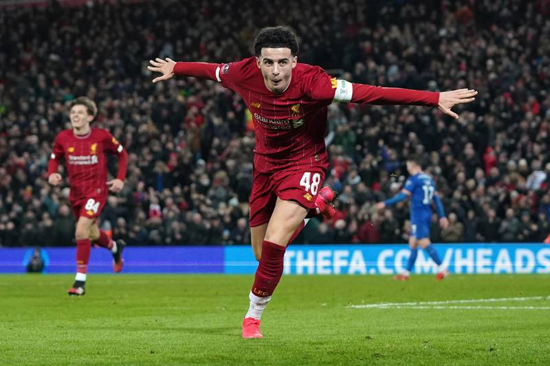 Liverpool's Curtis Jones celebrateS after Shrewsbury Town's Ro-Shaun Williams, scored an own goal during the English FA Cup Fourth Round replay soccer match between Liverpool and Shrewsbury Town at Anfield Stadium, Liverpool, England, Tuesday, Feb. 4, 2020. (AP Photo/Jon Super)