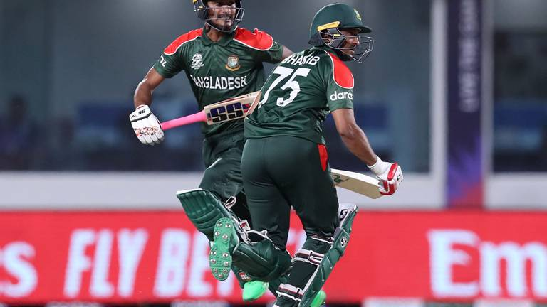 An image that illustrates this article T20 World Cup: Bangladesh stay in the hunt after win over Oman