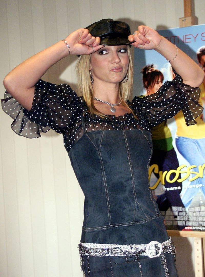NLD10 - 20020319 - AMSTERDAM, NETHERLANDS : American singer Britney Spears strikes a pose while in Amsterdam 19 March 2002 for the promotion tour of her new film Crossroad. EPA PHOTO ANP SVEN HOOGERHUIS