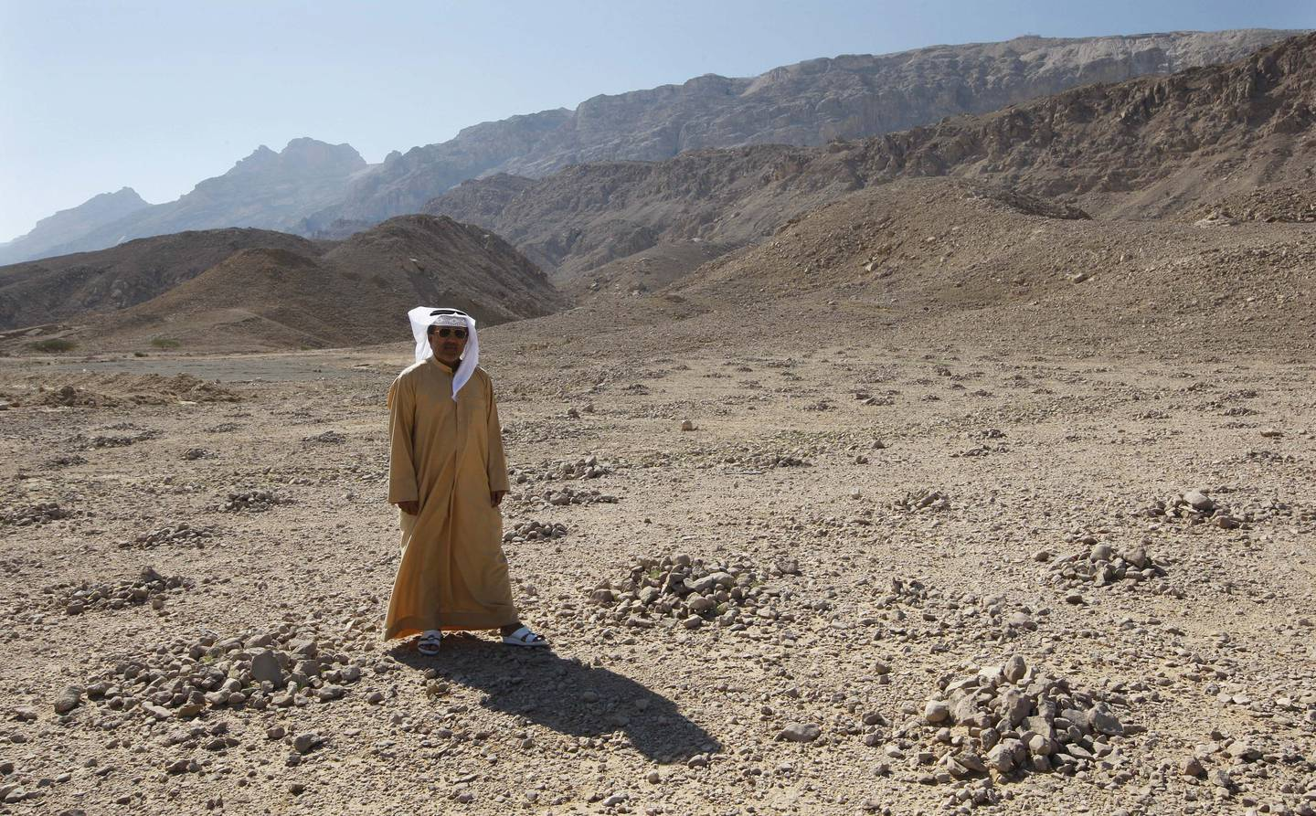 AL AIN 11th January 2010.  Hasan al Naboodah from the UAE University  stands beside some of the  small rock formations at Jebel Hafeet in Al Ain. Stephen Lock   /  The National   *** Local Caption ***  SL-rock-008.jpg