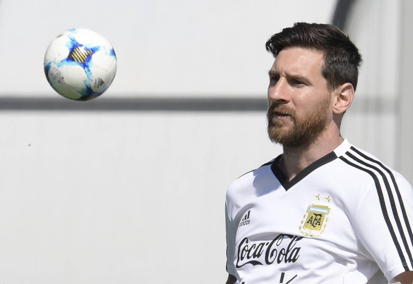 Argentina's forward Lionel Messi eyes a small ball during a training session at the team's base camp in Bronnitsy, on June 25, 2018 on the eve of the team's third game as part of the Russia 2018 World Cup Group D football match. / AFP / JUAN MABROMATA