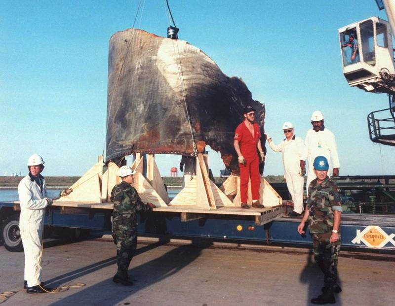 2-ton piece of space shuttle Challenger's right-hand solid rocket booster being off-loaded by crew of Stena Workhorse after recovery mission to assist process of studying accident which left crew of 7 dead. Kennedy Space Center  (Photo by Time Life Pictures/NASA/The LIFE Picture Collection via Getty Images)