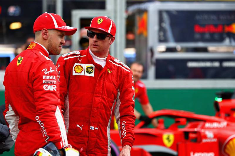 MELBOURNE, AUSTRALIA - MARCH 24:  Kimi Raikkonen of Finland and Ferrari and Sebastian Vettel of Germany and Ferrari talk in parc ferme after qualifying for the Australian Formula One Grand Prix at Albert Park on March 24, 2018 in Melbourne, Australia.  (Photo by Mark Thompson/Getty Images)