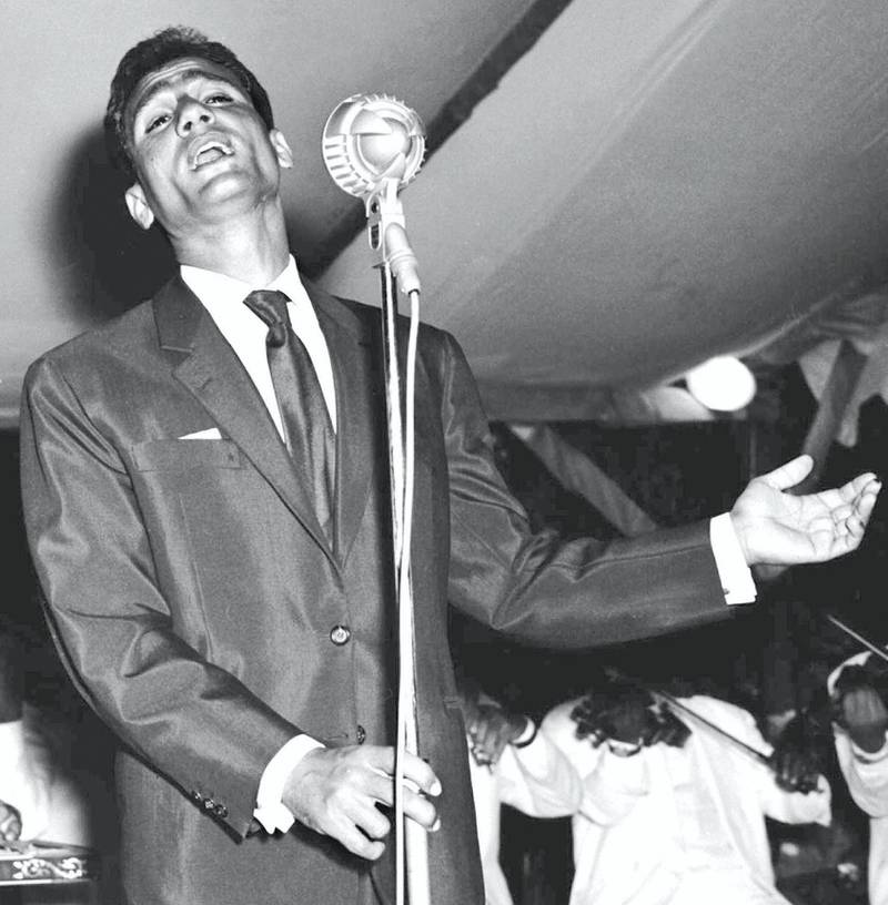 Picture taken in 1959 in the mountain resort of Aley, east of Beirut, shows Egyptian singer Abdel Halim Hafez during a live performance at the famous Piscine Aley grounds. Abdel Halim (1929-1977),  Egypt's most popular male singer ever, starred in 15 musical films and sang hundreds of songs that appealed to young generations throughout the Arab world for over three decades. He never married and died at the age of 48 of Bilharzia. / AFP PHOTO