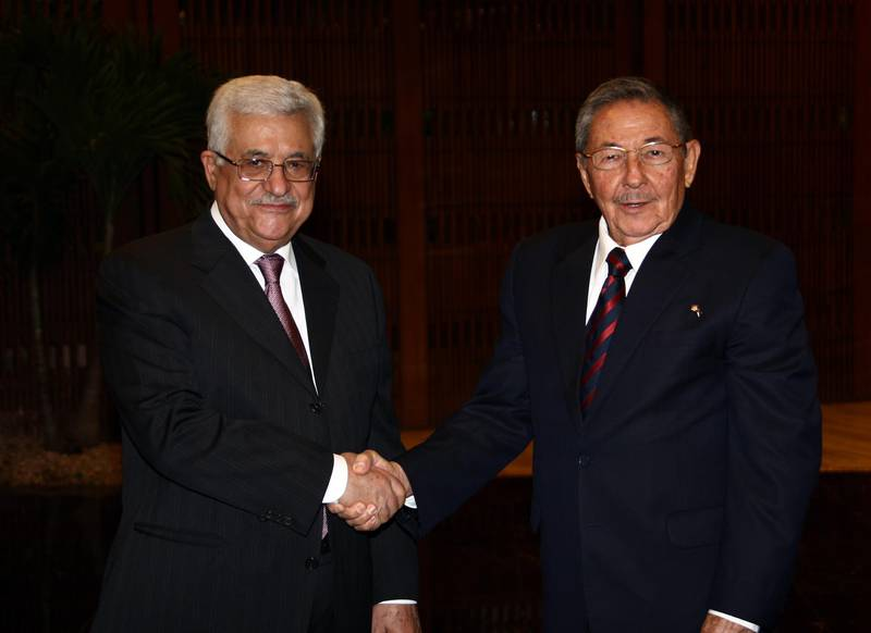 HAVANA, CUBA - SEPTEMBER 27:  In this handout image provided by the Palestinian Press Office (PPO), Palestinian President Mahmoud Abbas meets with Cuban President Raul Castro on September 27, 2009 in Havana, Cuba.  Abbas is in Cuba to strengthen bilateral ties, signing cooperation agreements in education, sport and culture. (Photo by Omar Al-Rashidi/PPO via Getty Images)