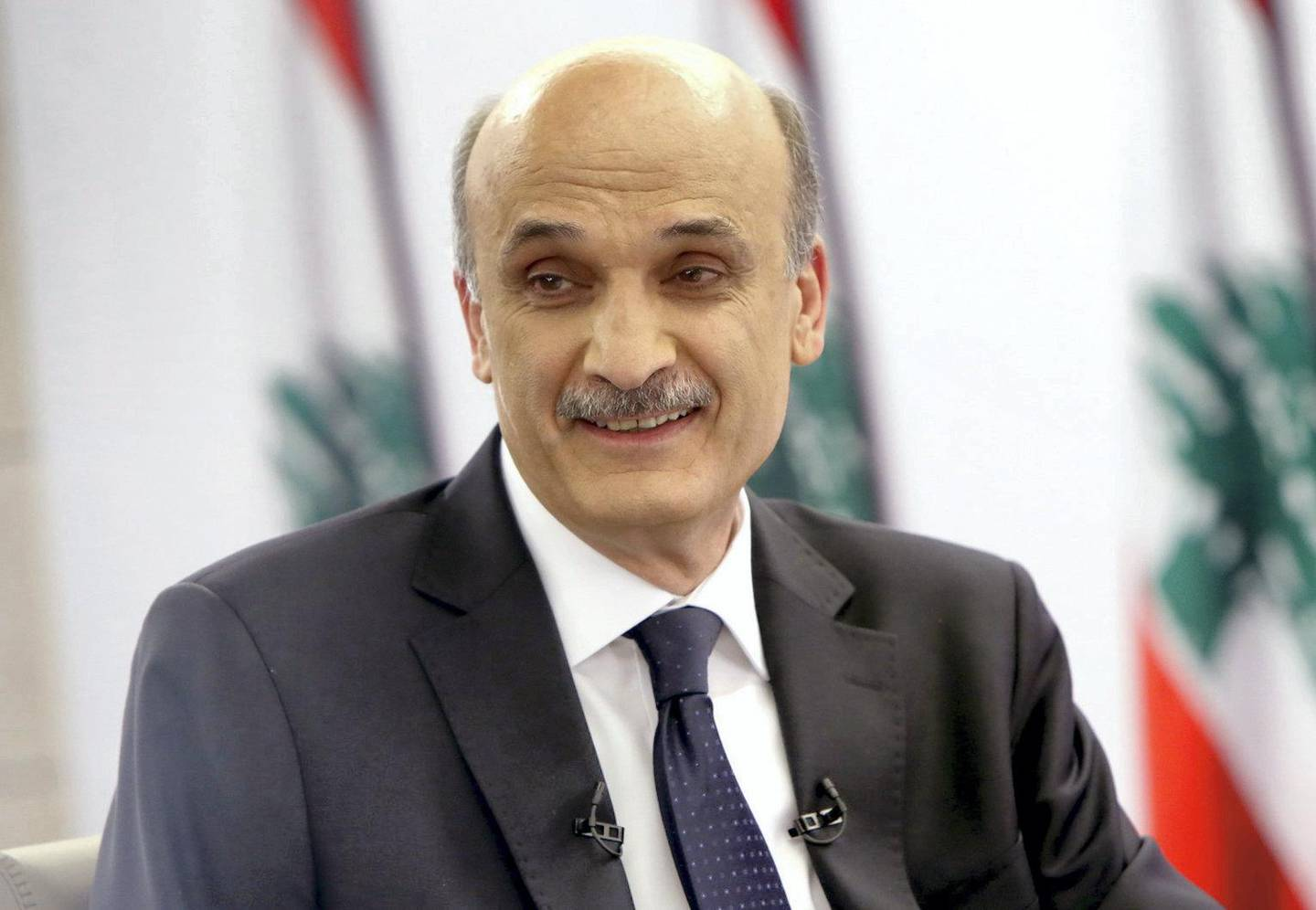 """A handout picture distributed by Lebanon's leading anti-Damascus Christian party Samir Geagea's press office on April 24, 2014 shows him during the broadcast of a special political show by Lebanese Broadcasting Corporation (LBC) station in Beirut. Geagea will run for the presidency in May, his Christian Lebanese Forces party announced on April 4, 2014 in a controversial move given his role in the 1975-1990 civil war and his opposition to Hezbollah. President Michel Sleiman's mandate ends on May 25 and there has been worries a successor will be hard to find because of disagreements between Lebanon's pro- and anti-Syria regime blocs. AFP PHOTO / GEAGEA'S PRESS OFFICE / ALDO AYOUB === RESTRICTED TO EDITORIAL USE - MANDATORY CREDIT """"AFP PHOTO / GEAGEA'S PRESS OFFICE/ ALDO AYOUB"""" NO MARKETING NO ADVERTISING CAMPAIGNS - DISTRIBUTED AS A SERVICE TO CLIENTS === / AFP PHOTO / GEAGEA'S PRESS OFFICE / ALDO AYOUB"""