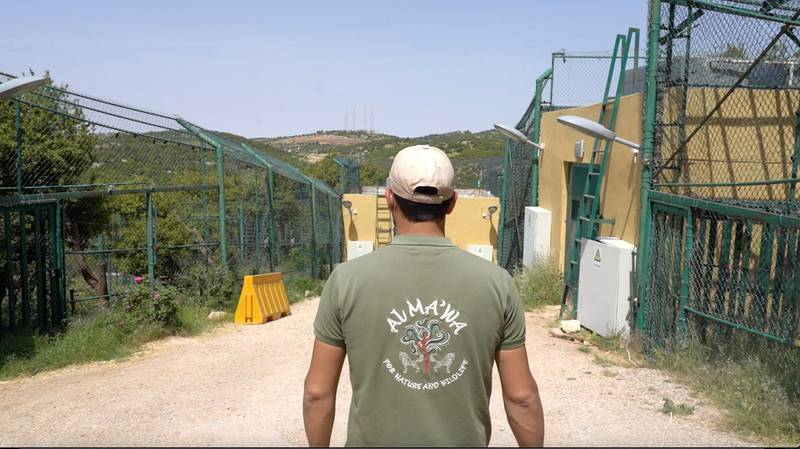 Chief animal keeper, Saif Rawashdeh, stands besides the bear cages as Al Mawa Wildlife Reserve. Amy McConaghy / The National