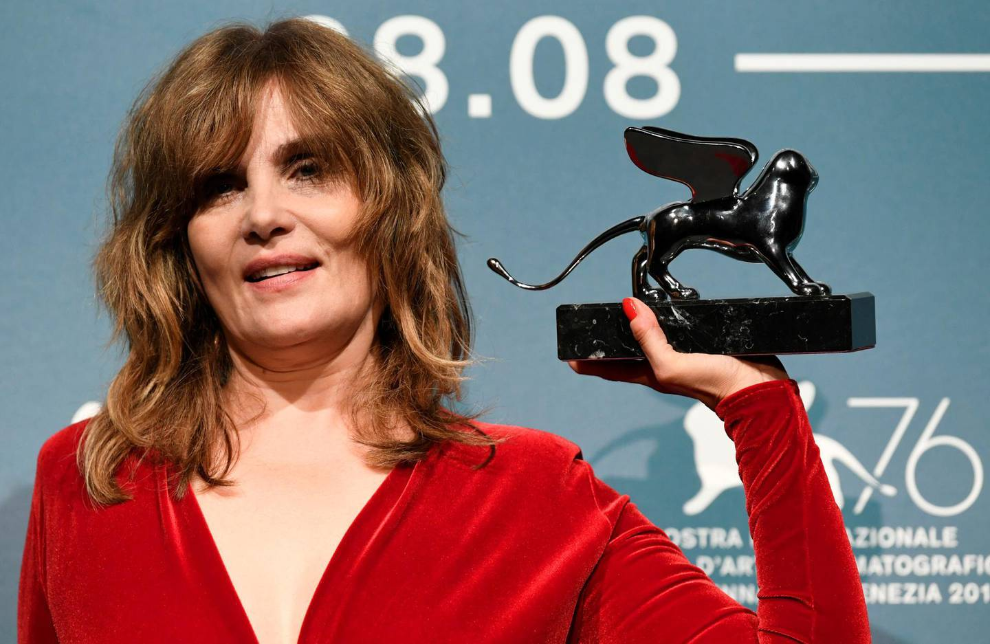 The 76th Venice Film Festival - Awards Ceremony - Venice, Italy, September 7, 2019 - Emmanuelle Seigner poses with the Silver Lion award - Grand Jury Prize. REUTERS/Piroschka van de Wouw