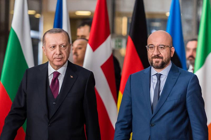 Recep Tayyip Erdogan, Turkey's president, left, and Charles Michel, president of the European Union (EU), arrive ahead of talks in Brussels, Belgium, on Monday, March 9, 2020. Ahead of high-level meetings in Brussels Monday, Erdogan urged Greece to open its borders to refugees, a call likely to further stir tensions with the EU as it grapples with the damage unleashed by the spread of the deadly and unpredictable coronavirus. Photographer: Geert Vanden Wijngaert/Bloomberg