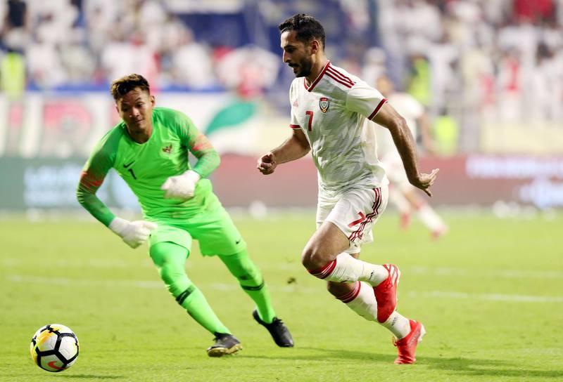 Dubai, United Arab Emirates - October 10, 2019: UAE's Ali Mabkhout scores his hatrick during the Qatar 2022 world cup qualifier between The UAE and Indonesia. Thursday 10th of October. Al Maktoum Stadium, Dubai. Chris Whiteoak / The National