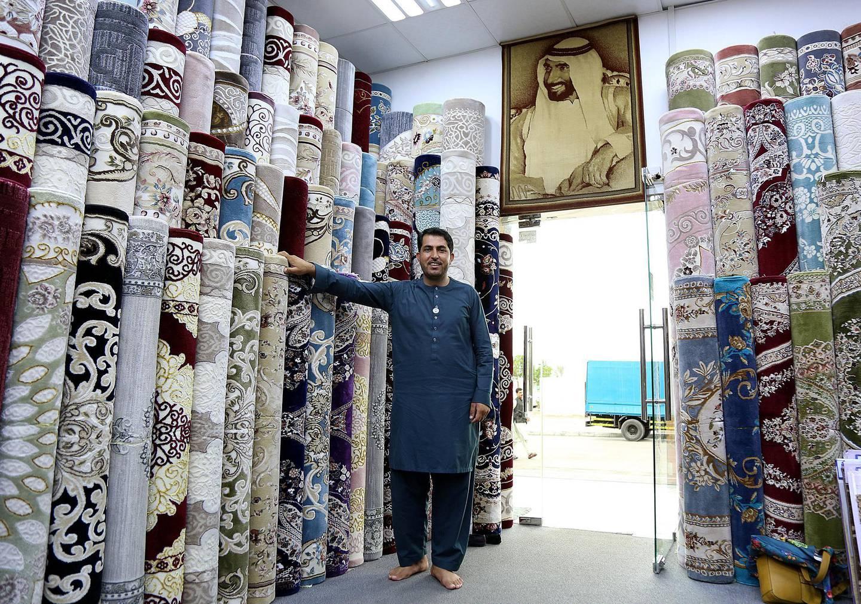 Abu Dhabi,Feb, 25, 2018: Mosa Khan Adbul Qadir pose during the interview at his Carpet shop in Abu Dhabi.  Satish Kumar for the National / Story by Anna Zacharias