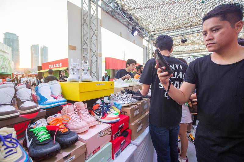 Dubai, United Arab Emirates- Visitors checking out shoes in one of the brand outlet at the Sole Dubai Festival at D3.  Leslie Pableo for The National for Saeed Saeed's story