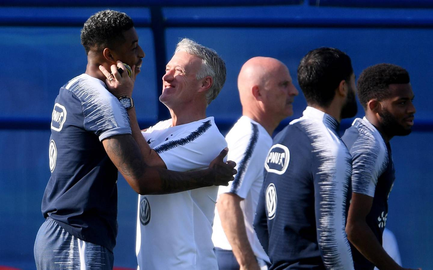MOSCOW, RUSSIA - JULY 12:  Head coach Didier Deschamps jokes with Presnel Kimpembe during a France trainig session on July 12, 2018 in Moscow, Russia.  (Photo by Laurence Griffiths/Getty Images)
